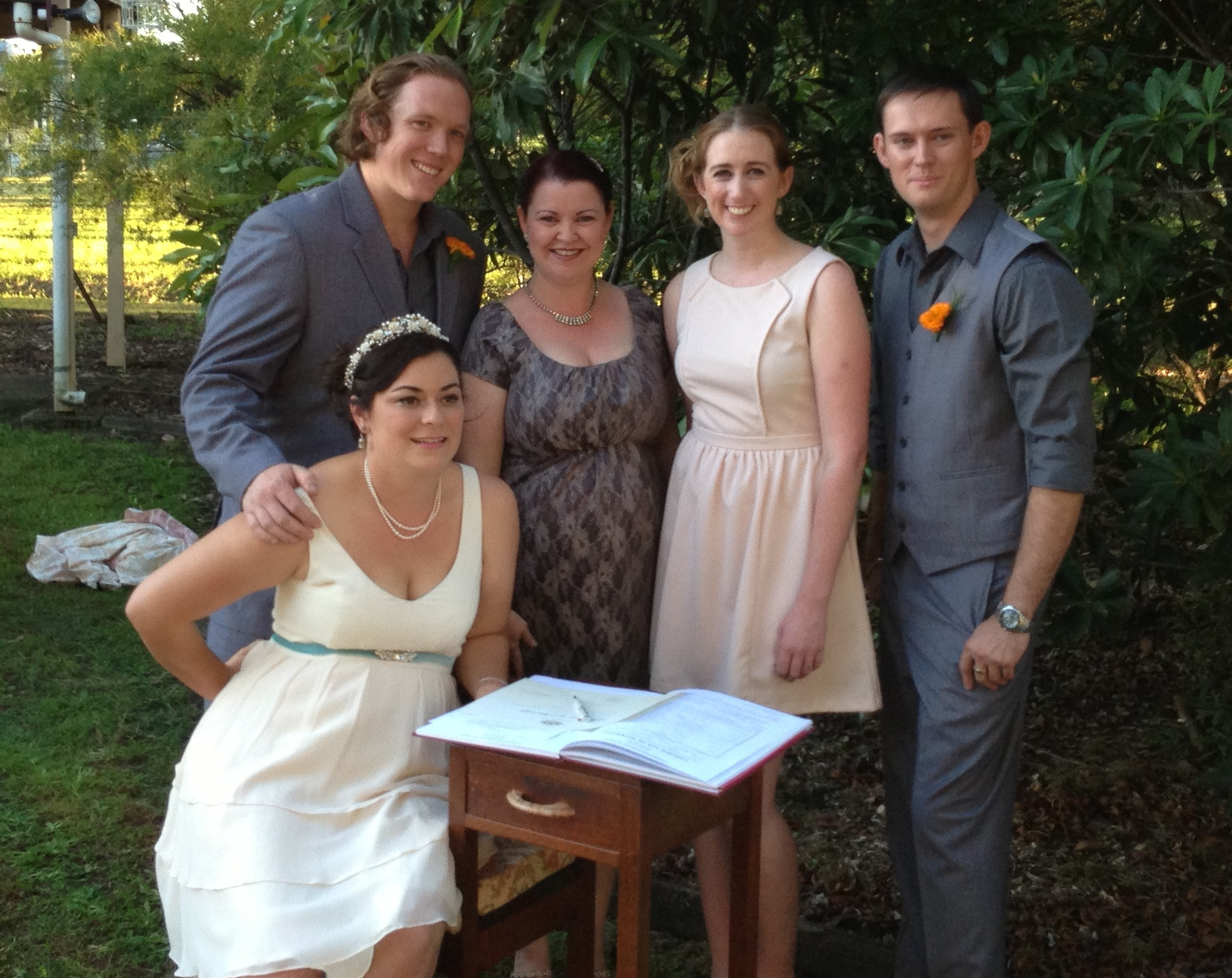Signing the marriage certificates and register!